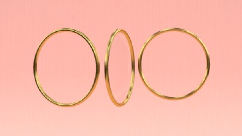 Three golden rings against a light pink background.