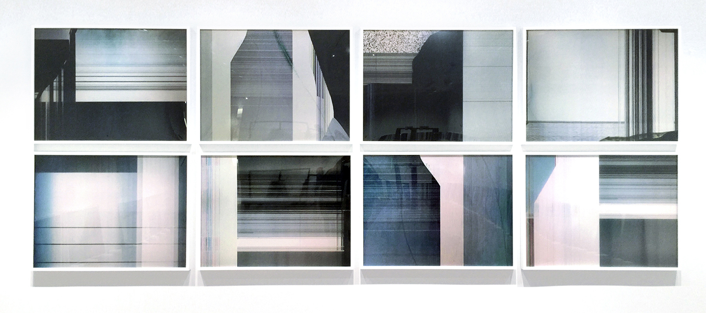 4x5 rows of glitching tv screens without their frames.