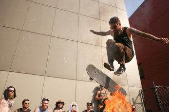 Matt Seavy, bassist and singer for Swamp Water, jumps fire.