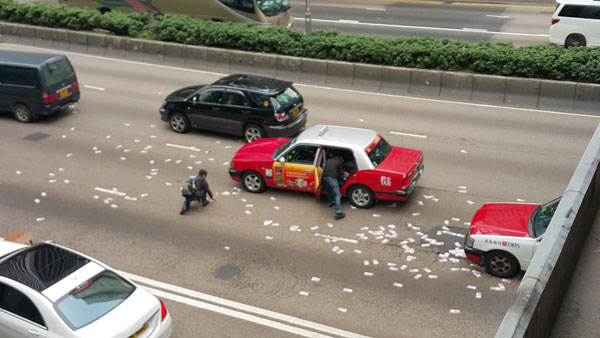 Van Spills Millions Worth of Notes on a Busy Hong Kong Road