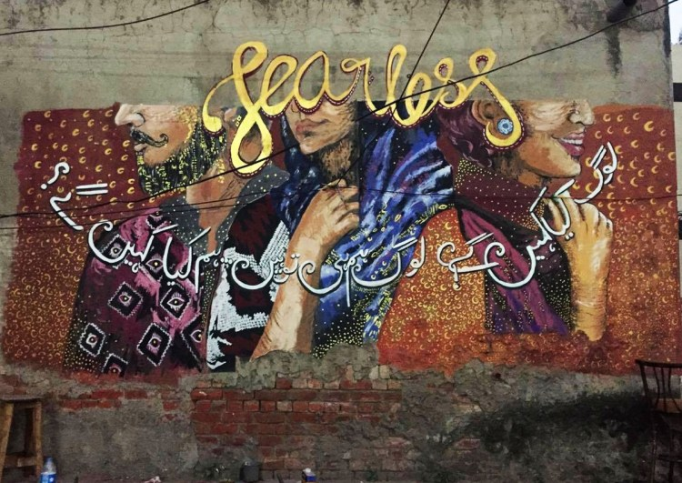 """The Lahore mural was painted on the walls of the country's largest bank, the National Bank of Pakistan, in the city's historic Anarkali market. The text questions the fear of being judged by society with the words """"Log kia kaheinge, hum hi tou log hain, hum kia kahenge"""", implying that at the end of the day, it's all of us who make this society and these collective judgements."""
