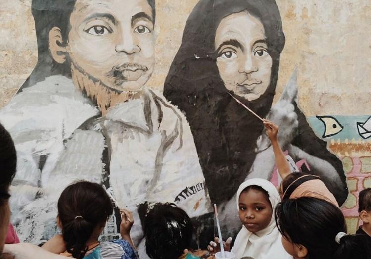 The children of Lyari, Karachi, painting a mural.