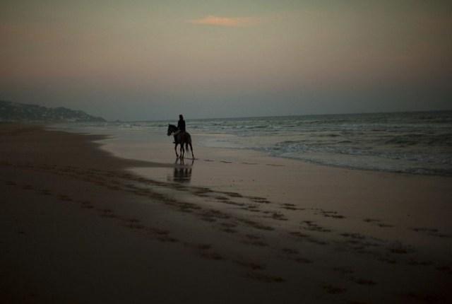 Muslim woman riding horse