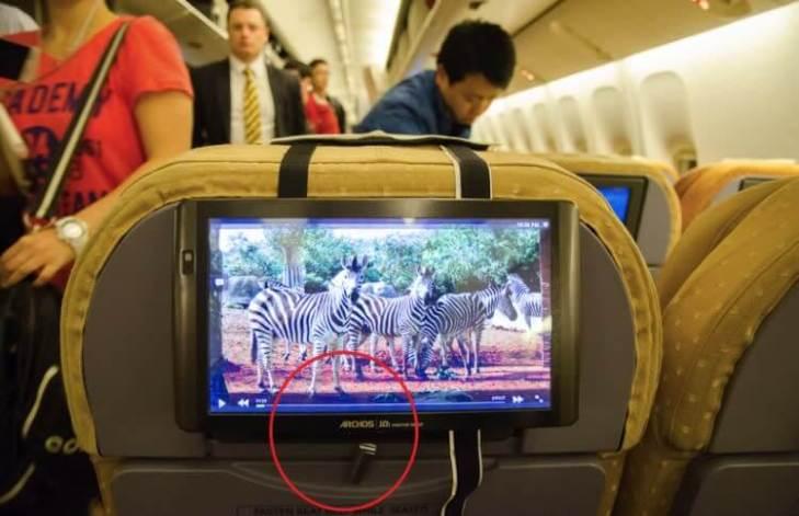 Usando El Anillo Del Asiento De avión