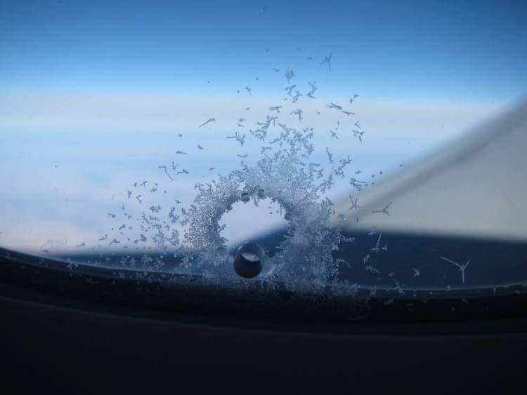 Why There Are Holes in Airplane Windows?