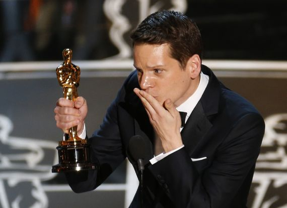 Graham Moore shows his Oscar some love.  Mike Blake/Reuters.