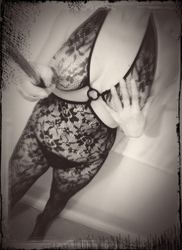 female in lace bodystocking