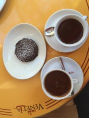 Thick hot chocolate w pizelle. So thick, like warm chocolate pudding, we ate with a spoon!