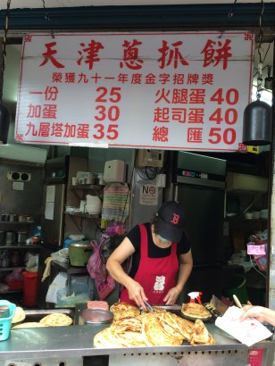 M's favorite breakfast place: a scallion pancake stall that often had a line 15+ people long. You can eat well for < $2 USD!