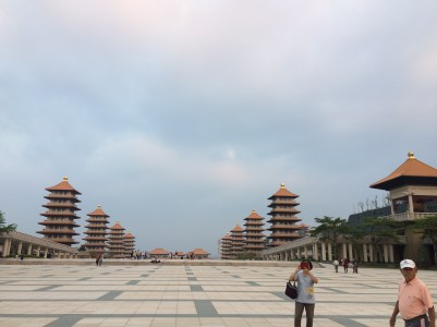 Walking away from giant Buddha at Fo Guang Shan Buddhist Museum