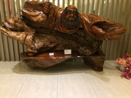 Funny carved wood sculpture at Fo Guang Shan buddha museum