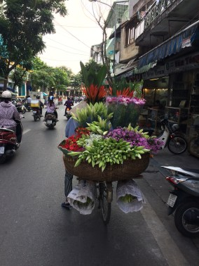 Street vendors are everywhere, and more often than not they are women. She is selling flowers -- the work hours are long and the pay is low, but these bikes filled with flowers bring bursts of color all over the city.