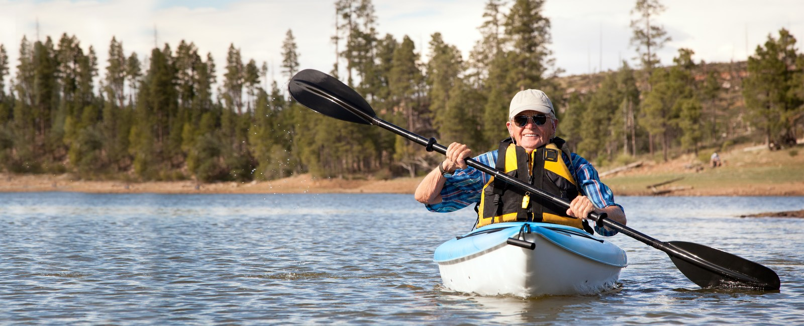mature man kayaking on the river