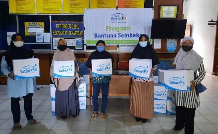Rumah Yatim Bagikan Bantuan Kemanusiaan untuk Warga Prasejahtera Senapelan Pekanbaru