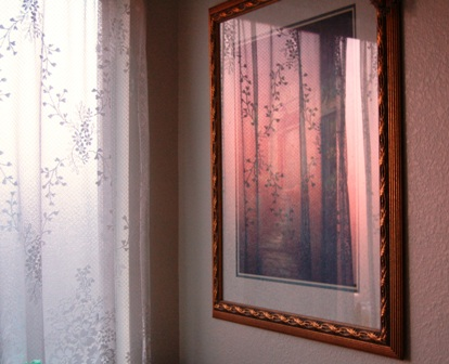 """sunset reflection in painting above """"garden tub"""""""