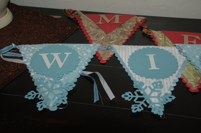 """I made 15 """"winter banners (the snowflakes dangle) and 4 """"merry"""" banners as gifts."""