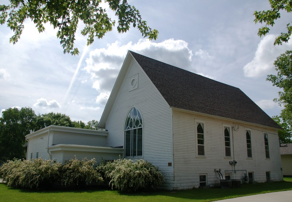 """""""Pa"""" helped build the frames for the stained glass windows in this church. The Ingalls family would probably flip if they saw the VBS program they were doing this summer.  (The same one my church did which nearly made me flip.)"""