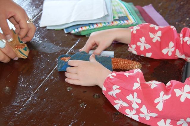 Chicklet making her corncob doll