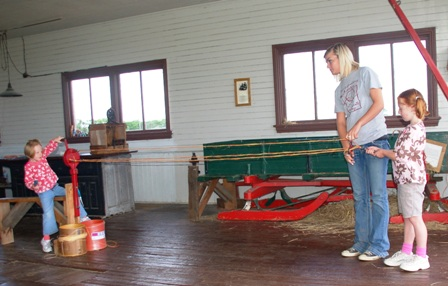 Chicklet twisting to make her rope while Chic holds it.