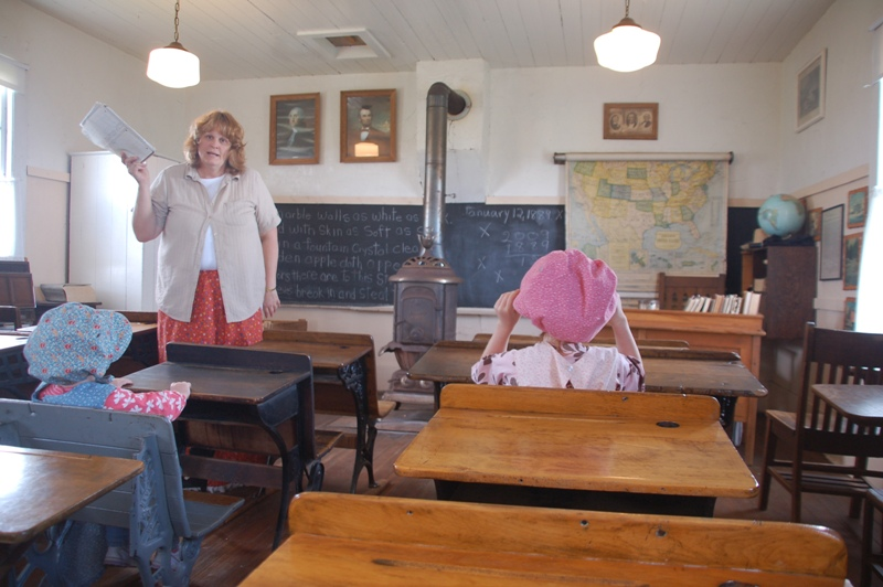 Learning about Laura while dressed in pioneer clothes.