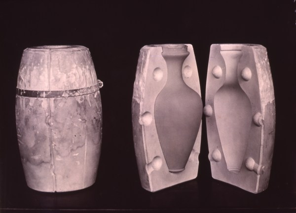 open mold shows clay vase inside