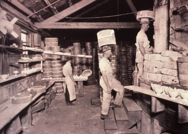 loading kiln with saggers of greenware