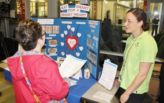 Dietitian Gretchen Skwer of Bryn Mawr Hospital, right, talks about the importance of eating smart to be heart healthy during a senior expo at the Blue Bell MCCC campus on May 13.