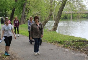 People take a walk along the Schuylkill River Trail in Pottstown. Both the river and the trail are great opportunities for outdoor summer fun.
