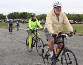 People with smile on their faces bicycle from the start of the first Ride for the River which was held in conjunction with the Sly Fox Can Jam Festival in Pottstown. After biking to Union Township, the group returned to the festival for a total of 16 miles.