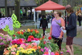 People look at a very colorful display of flower arrangements for sale during EarthFest at Boyertown Community Park on Saturday, April 22, 2017. Michilea Patterson — Digital First Media