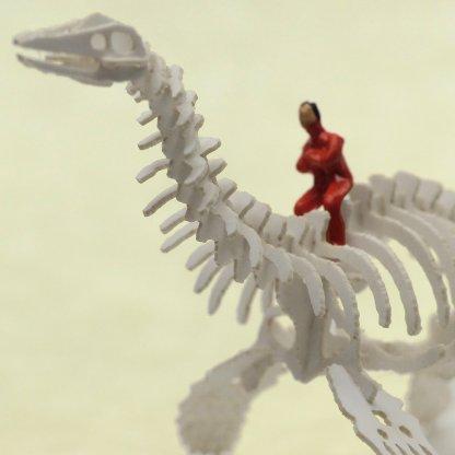 Tiny hand-painted person riding a plesiosaur Tinysaur skeleton
