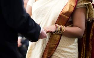 holding-hands-rings-ceremony-poundon-house