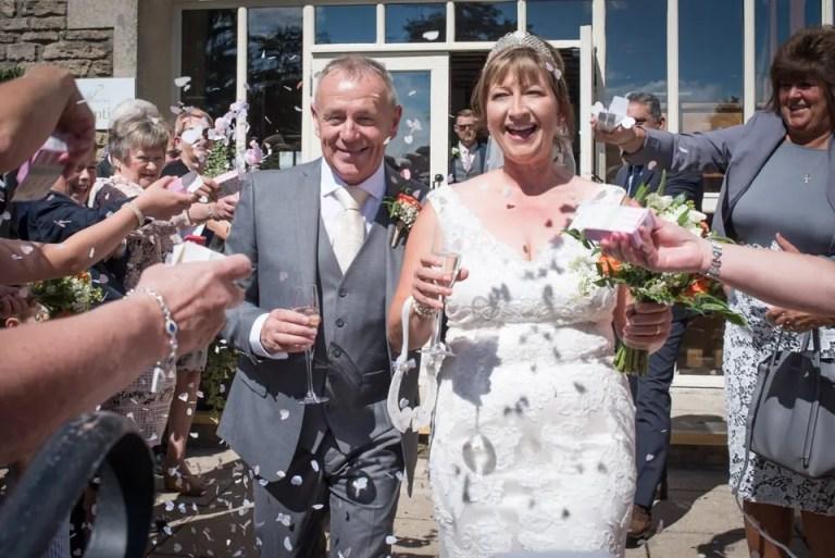 Bride and groom confetti at Cumberwell park wedding venue