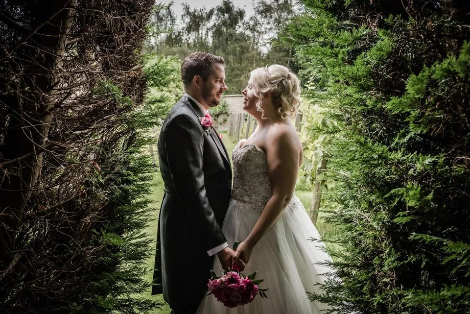 Bride and Groom on their Wedding Day at Leigh Park hotel in Wiltshire
