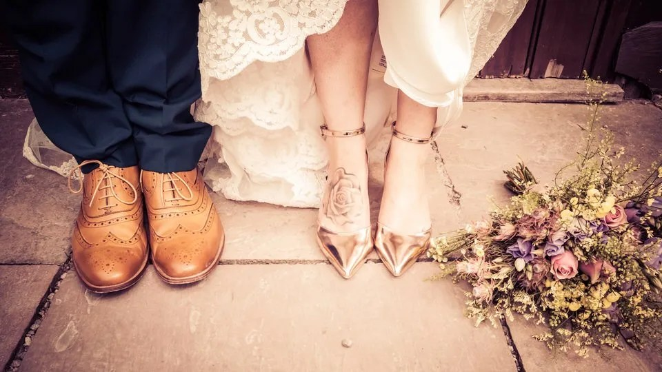 Bridal shoes at Mells Tithe Barn in Somerset