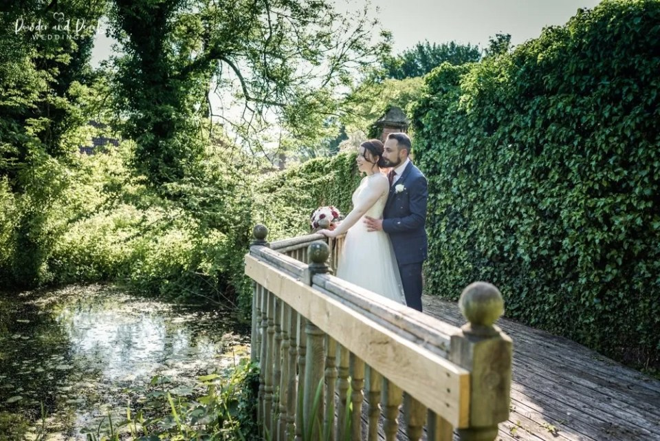 Crowcombe court wedding couple look out over spring