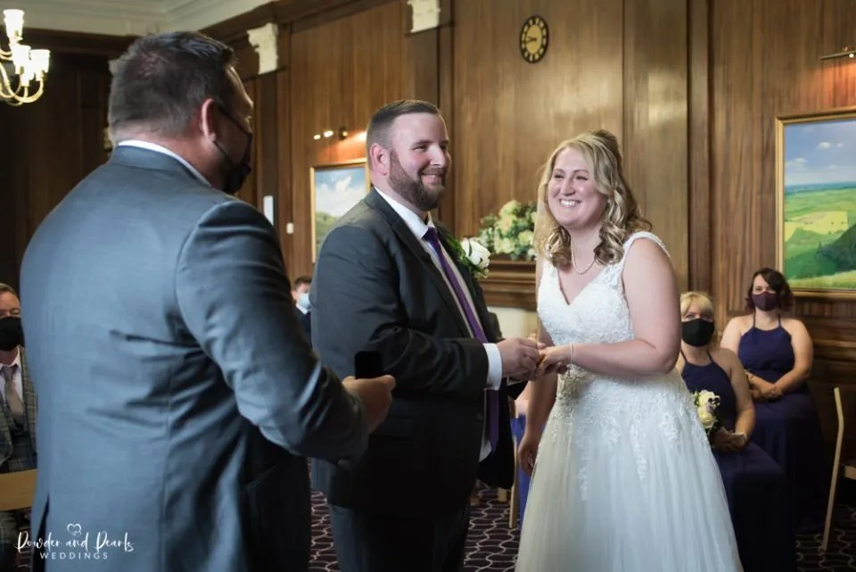 The bride and groom laugh during the Trowbridge registry office wedding ceremony