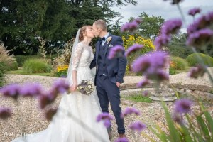 Bride and groom kisses at Dillington House