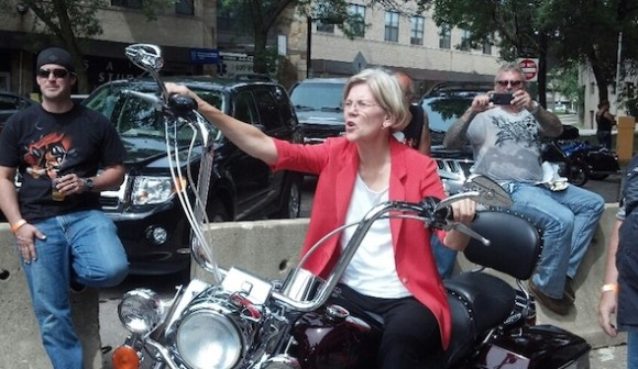 Elizabeth Warren acting tough. Don't worry, the motorcycle is standing still.