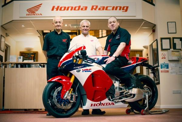 RC213V-S handover L-R Dave Hancock (Honda), Neil Tuxworth (Honda) and John Brown (owner)