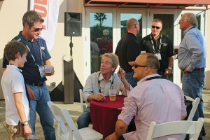 Kevin Cooper (left) of Manheim Specialty Auctions talks with attendees at the Manheim-sponsored Powersports Business Institute @ AIMExpo Kickoff Networking Reception in October.