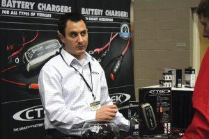 Matt Ingram, regional sales manager for CTEK Power, Inc., the Ohio-based U.S. subsidiary of CTEK Sweden AB, discusses the battery charger at Dealer Expo.