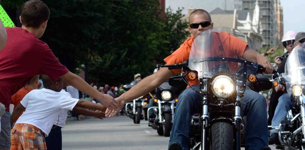 Tens of thousands of local fans line the streets of Milwaukee as nearly 7,000 Harley-Davidson riders paraded about five miles through the downtown streets.