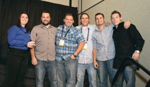 Nate Stickney of DeLand Motorsports in Florida is joined by his team to accept the Power 50 No. 4 dealer award.