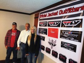 (From left) Ron Bentzinger, snowmobile product manager for Western Power Sports, Dave Consoer, sales & marketing manager for the Eagle River Derby, and Wendy Gavinski, president of Divas SnowGear, finalized the deal.