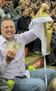 Dave Hrejsa, Great Lakes Region sales manager for CFMOTO, pulled out a winner during a promotion that saw dollar bills rain down from the rafters at Target Center.