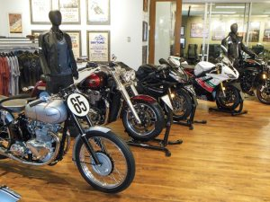 Triumph North America's offices in Atlanta feature up to 30 bikes on display in hallways and offices. Autographed memorabilia and posters from motion pictures that featured Triumph bikes also grace the office walls.