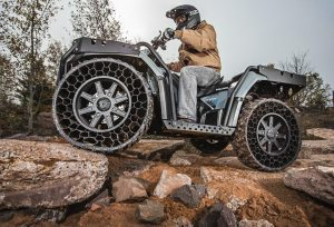 Polaris reports that its non-pneumatic tires will be available on a variety of consumer ATVs and side-by-sides beginning later this year.