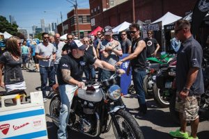 """A member of the Team Triumph dealership shows off his group's creation, """"Gypsy,"""" to the crowd at Motoblot, which was held June 13-15 in Chicago."""