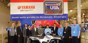 Yamaha officials celebrate the production of a Grizzly 700, the 3 millionth unit to roll off the assembly line at the company's Newnan, Ga., factory.